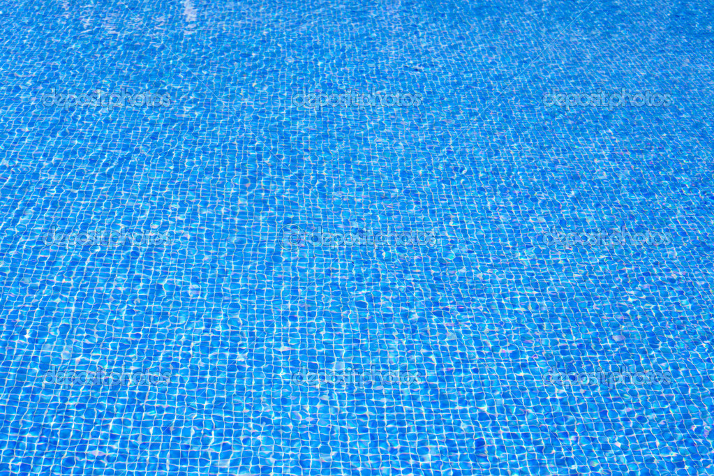 Blue tiles pool water texture on summer day stock photo for Blue water parts piscine
