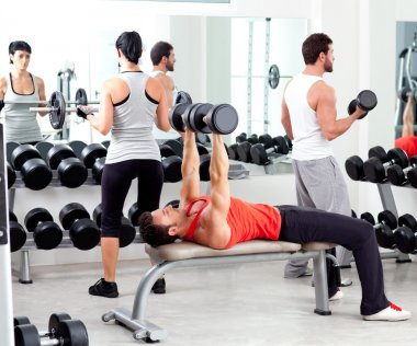 Group of in sport fitness gym weight training