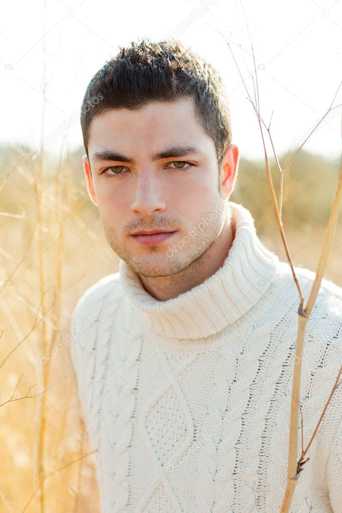 Autumn winter man portrait in outdoor dried grass
