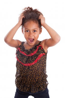 Little African Asian girl holding her head