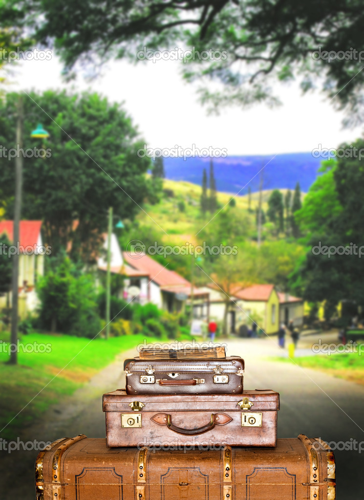 Traveling suitcases in a small town street