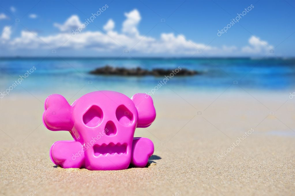 Pink toy on the beach showing danger