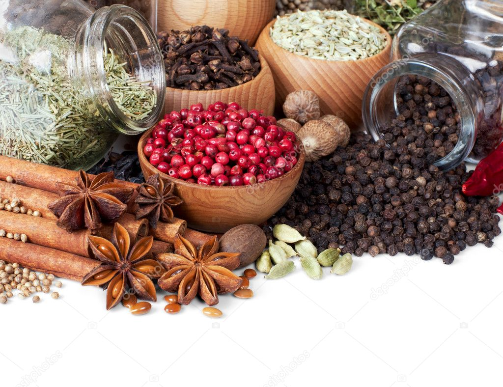 Background of different spices on white