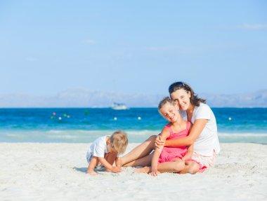 Happy family on tropical beach