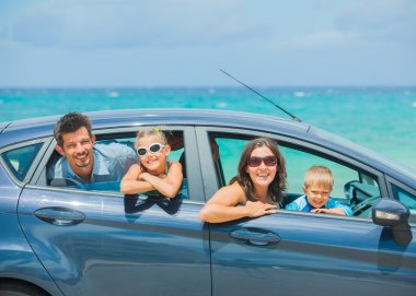 A family of four driving in a car
