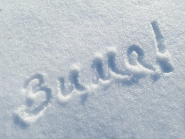 Background from snow with inscription on snow