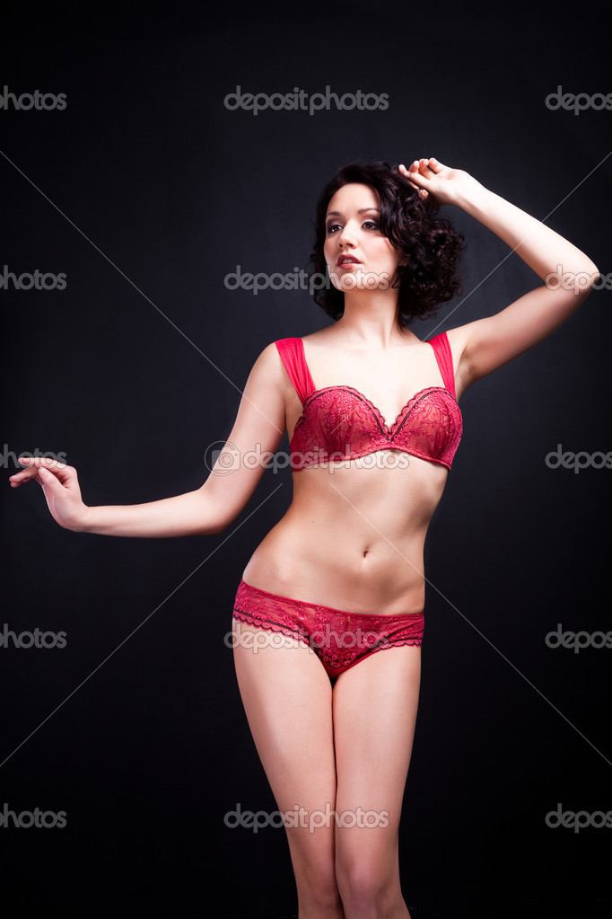 e15c5eee2 Beautiful young woman wearing elegant lacy red underwear on black background  — Photo by ...