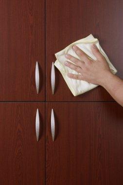 Polishing the door of closet