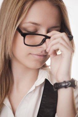 Tired girl in glasses