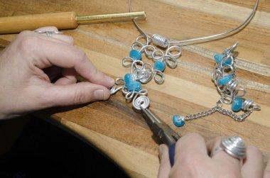 Woman's hands creating a fashion jewelery