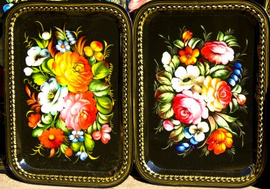 Tray painted in traditional style called Zhostovo, Russia