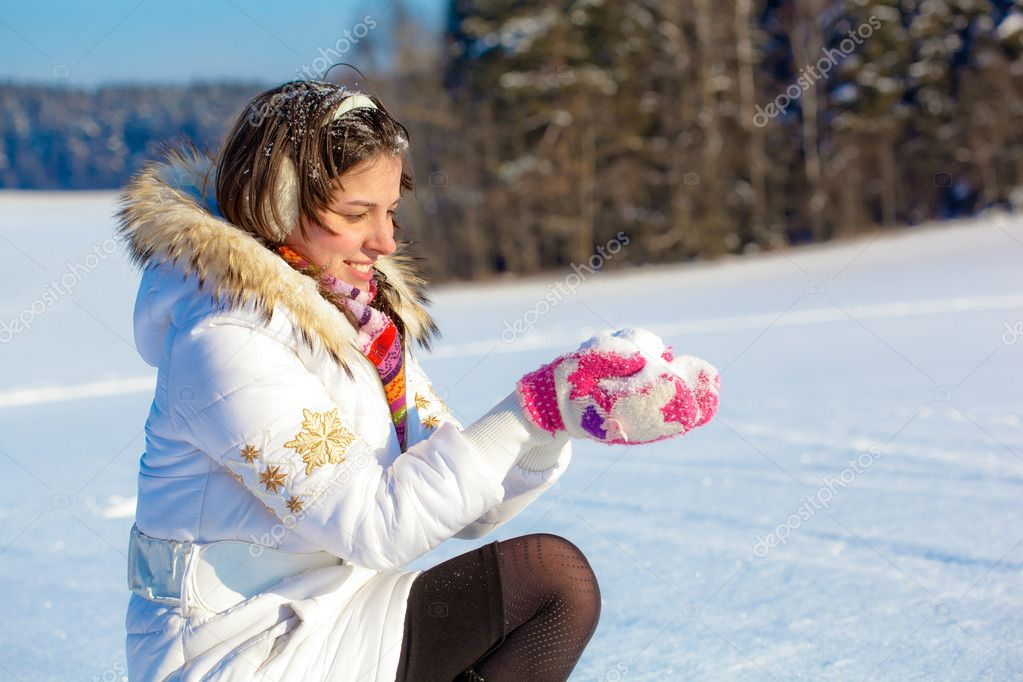 Pretty student girl with snow in palms