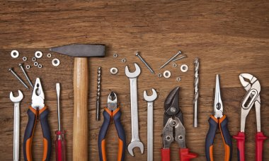 Set of different tools on wooden background stock vector