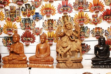 Traditional masks and buddha statue of the devil at the shop