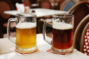 Glasses with light and dark beer in a cafe