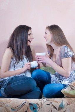 Happy teen friends tea time