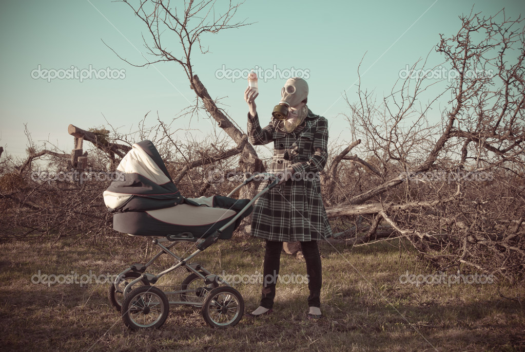 Mother in gas mask with baby buggy