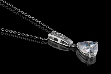 Diamond pendant with chain isolated on black