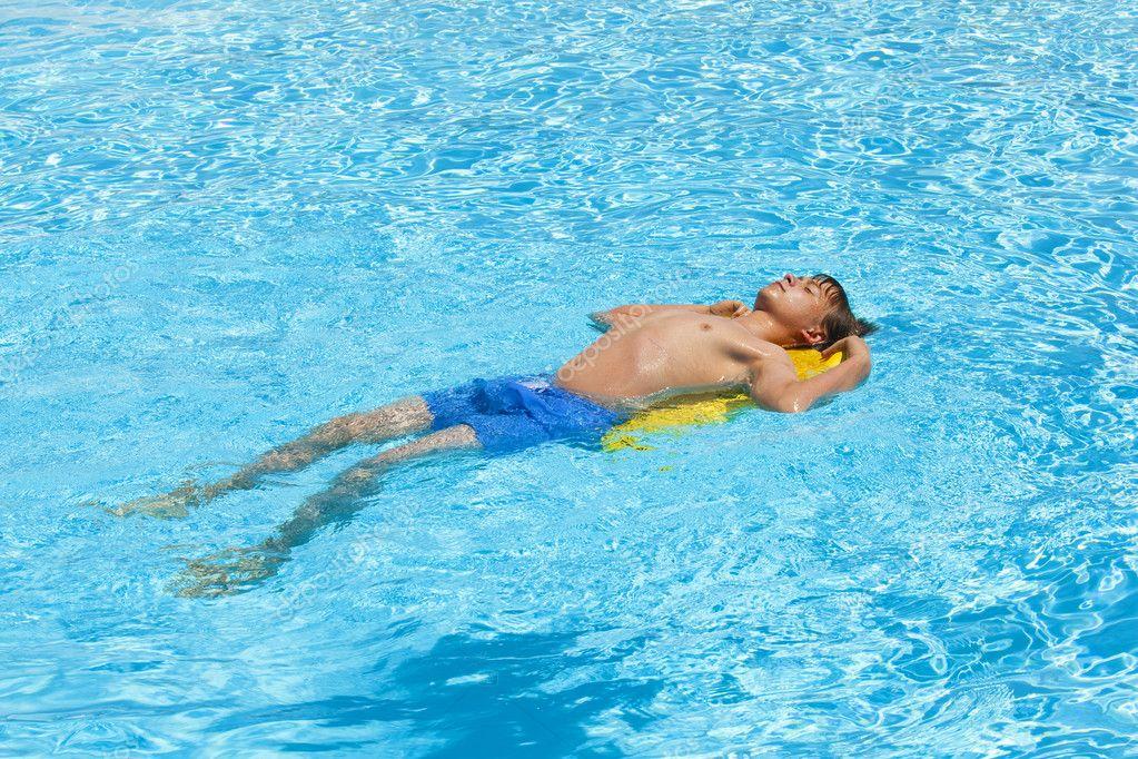 Boy swimming in the pool