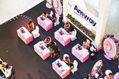 Hostesses from AMWAY are advising customers how to use their pro