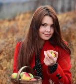Beauty girl with apple outdoors