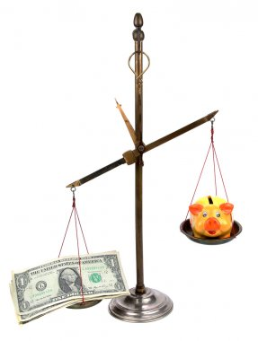 Pharmacist scales with money and piggybank