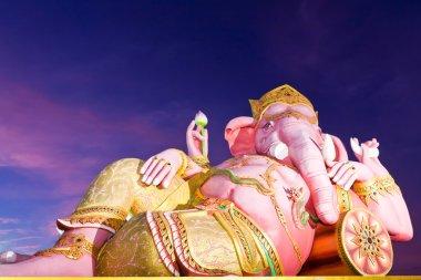 Ganesha statue in twilight tilted