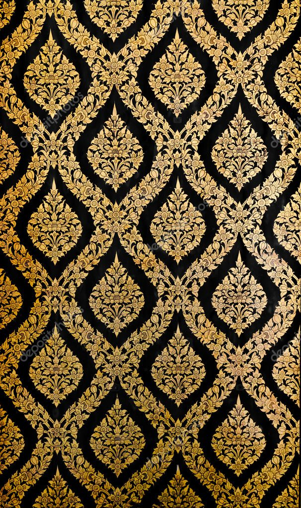 Golden Thai pattern on black wall