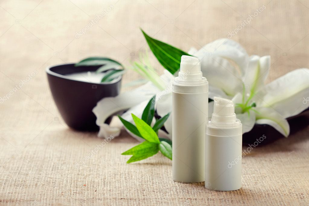Face/body care concept: bottles of creams/lotions/serums with wh