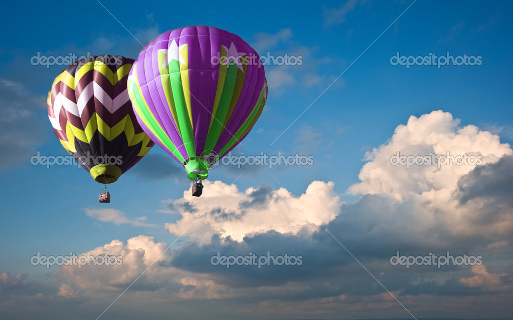 Stunning blue sky cloud formations with hot air balloons