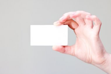 Arm holding businesscard with empty place for information and logo