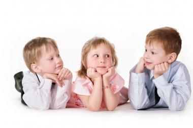Three children on a white background
