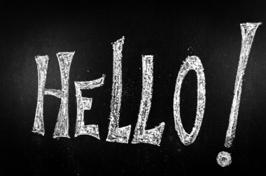 Hello written on a black chalkboard