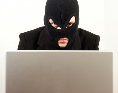 Woman internet hacker using laptop to rule the world