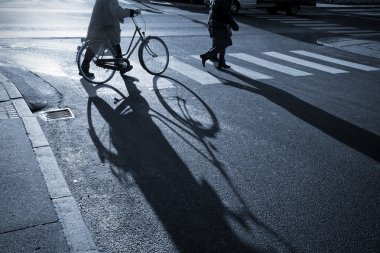 Senior female with bicycle