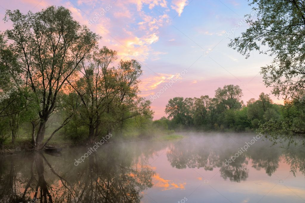 Fog and warm sky over the Narew river, Poland.