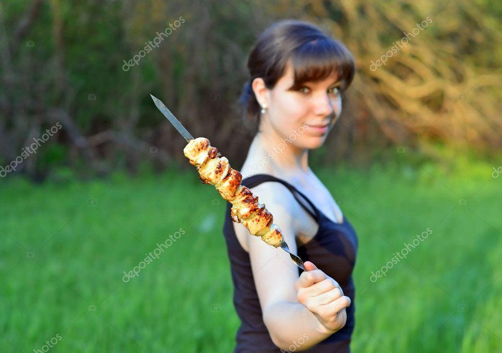 Woman with shish kebab