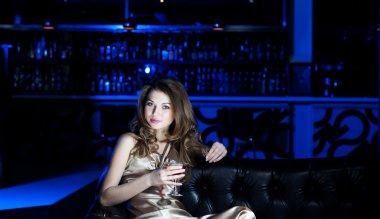 Portrait of the young beautiful woman, rest in bar