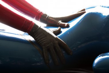 Red and Blue Latex Rubber Catsuit Girls