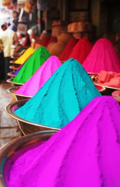 Colorful piles of holi powder dye at mysore market