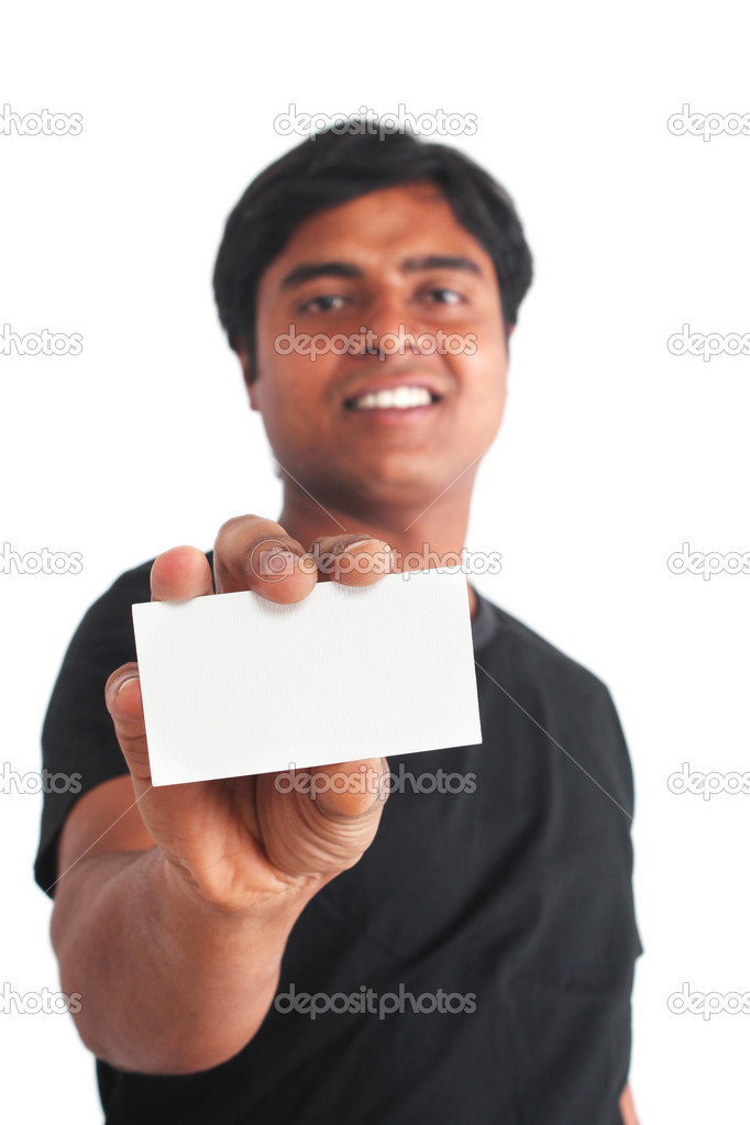 Young indian guy holding business card — Stock Photo © smarnad #9362399