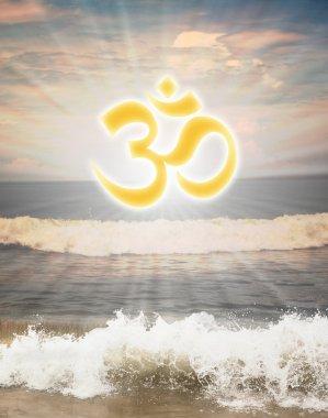 Hindu religious symbol om or aum against sun shine