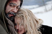 Fotografie Freezing homeless couple hugging