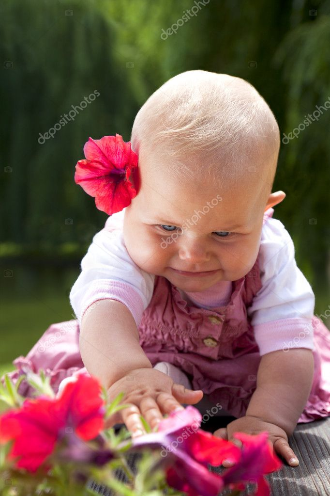 a63ff3befc Baby girl reaching flowers — Stock Photo © vilevi  9217394