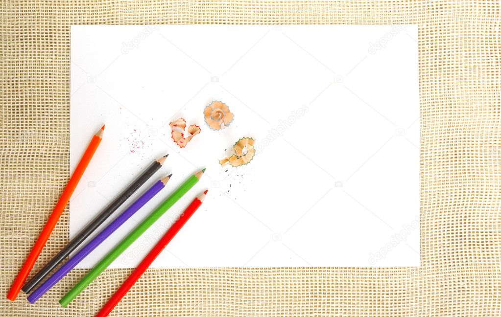 Paper on burlap with pencils