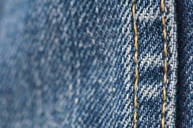 Orange stitch on the denim garment