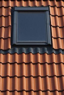 Dormer on a tiled roof