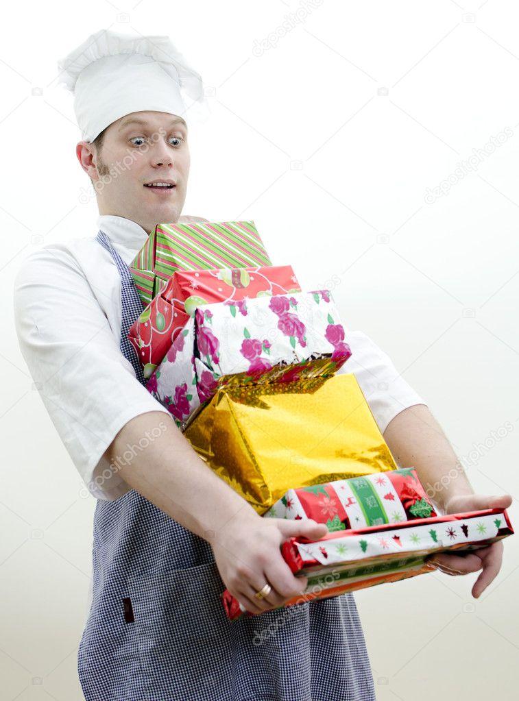 Chef Koch mit viele Weihnachtsgeschenke — Stockfoto © dmitrimaruta ...