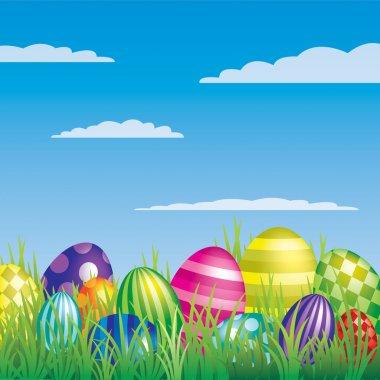Vector Easter eggs hiding in the grass.