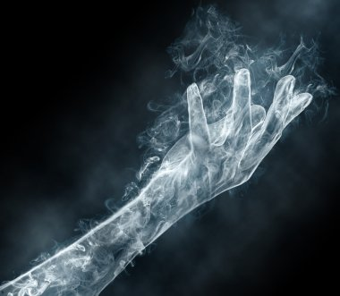 Female hand from a smoke